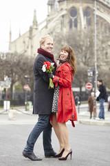 Couple dancing near Notre Dame de Paris