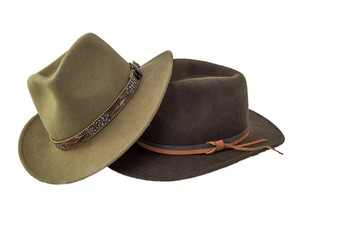 Two outback style hats one green one brown isolated on white
