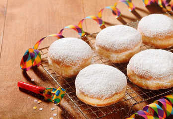 Homemade Doughnuts with Sugar on Metal Screen