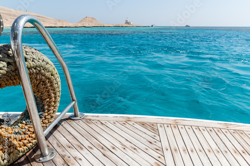Close-up of a wooden deck end of a yacht - 77899644