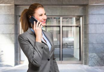 Businesswoman using a cellphone