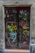 Door covered with graffiti