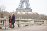 Couple in love in Paris, near the Eiffel tower