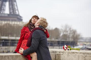Couple in love in Paris, near the Eiffel tower