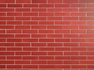 Wall bricks and cladding as building materials.
