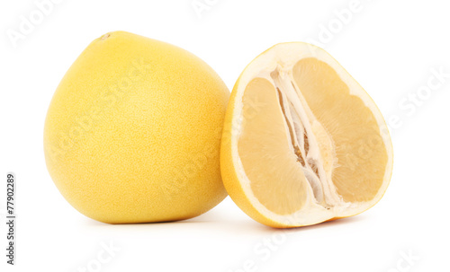 One whole and a half ripe pomelo (isolated) © ArtemSam