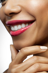 Smiling black woman with healthy beautiful white teeth