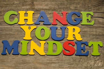 Change your mindset text on a wooden background
