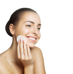 Smiling young woman cleans healthy skin
