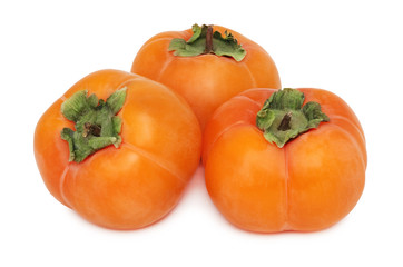 Three whole persimmons (isolated)