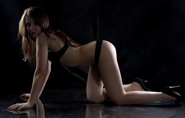 Photo of sexy young woman on the floor