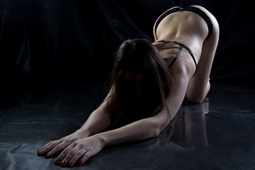 Image of hot young woman on the floor
