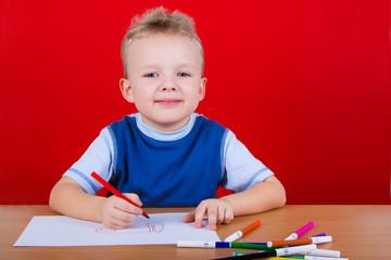 Small boy draws