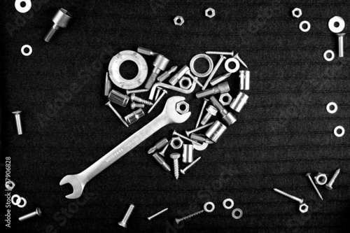 heart of the tools and screw nuts in black - 77906828