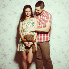 Stylish pregnancy concept: portrait of happy  couple of hipsters