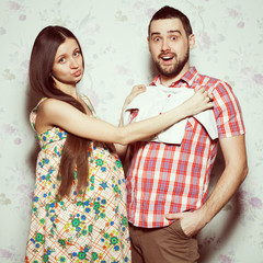 Stylish pregnancy concept: portrait of funny couple of hipsters