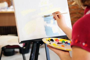 Woman paints a picture