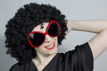 Red lipstic women wearing a black wig hand on her head