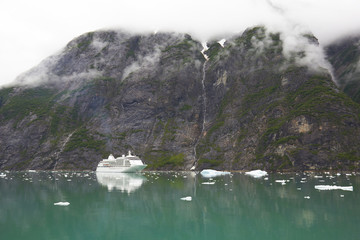 Alaska Cruise Ship Near Mountain with Clouds