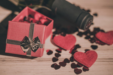 bottle of vine, red hearts and small present a retro style