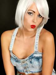 Attractive Young Woman Wearing Dungarees