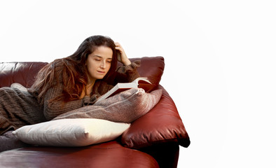 woman in relax over sofa reading a book