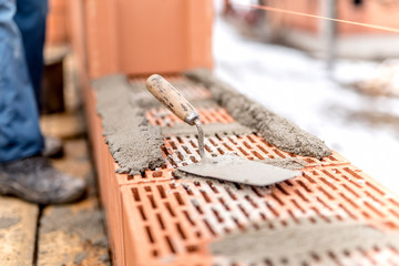 Detail of construction site, trowel or putty knife