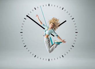 Blond athlete jumping in the clock