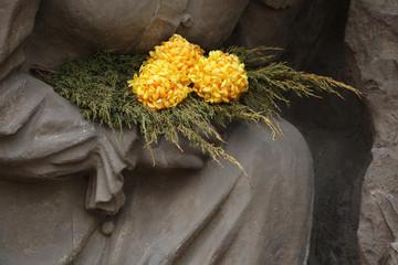 Yellow chrysanthemum at the cemetery in Jaromer, Czech Republic.