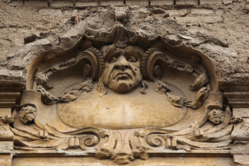 Funny mascaron on the Art Nouveau building