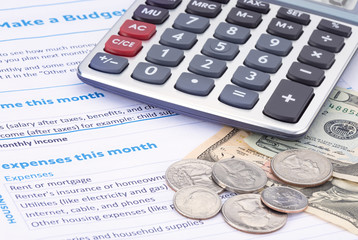 Household budget worksheet with calculator and money