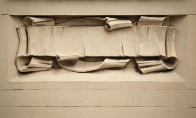 Medieval parchment scroll. Stucco decoration on the Art Nouveau