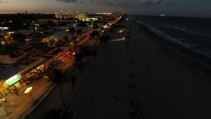 Aerial flyover Hollywood Beach at night 4k