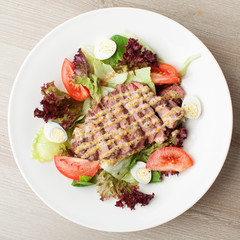 Fresh beef salad with lettuce, tomatoes, boiled eggs, mustard sa