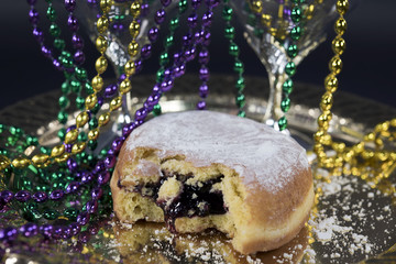 blueberry paczki with Mardi Gras party beads
