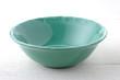 Empty ceramic bowl on wood