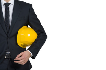 businessman engineer holding helmet