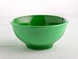 Empty green ceramic bowl on wood