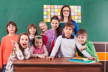 Children in elementary school with their teacher