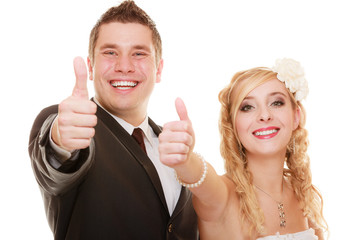 Wedding couple. Bride and groom showing thumb up