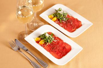 Carpaccio, dish of raw beef meat.