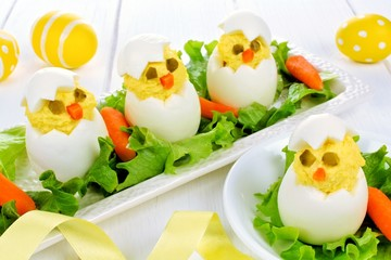 Fun Easter breakfast of hatching chicks made of boiled eggs
