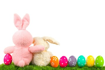 Hugging Easter bunnies on grass with colorful egg border