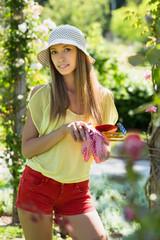 Smiling florist in yard gardening