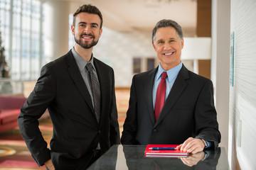 Portrait of two handsome caucasian businessmen