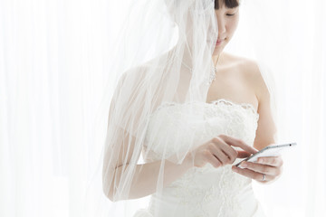 Bride that using a mobile phone