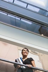 Businesswoman in the atrium of office building
