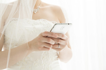 Bride is sending an email on mobile phone