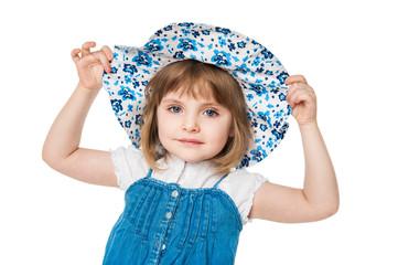 Portrait of a little girl in a blue hat