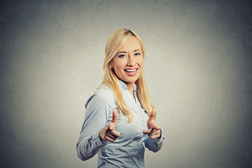 Happy woman with two thumbs up guns hand gesture pointing at you